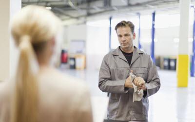 Car Mechanic & Owner Maintaining Social Distancing